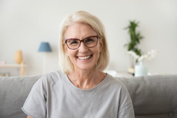 Woman Who Receives Home Health Assistance Smiling at Camera